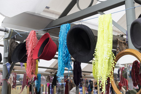 Sciarpe: Market stall with colourful hats and scarves