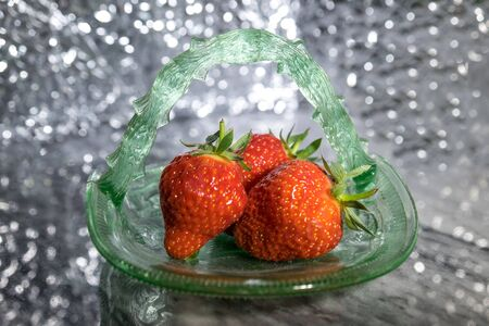sparkly: Green glass dish of strawberries against a sparkly background