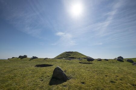 lothian: Sun shines in blue sky over the ancient ritual site of Cairnpapple Hill in West Lothian Scotland