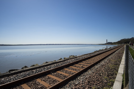 forth: Railway line running along the Firth of Forth at Culross, Fife, Scotland