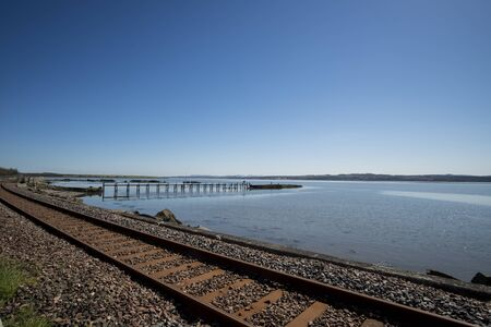 fife: Railway track running alongside the Firth of Forth at Culross, Fife, Scotland