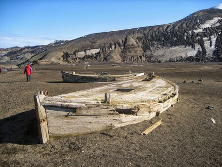 Abandoned whaling boats on Deception Island, the caldera of an active volcano in Antarctica