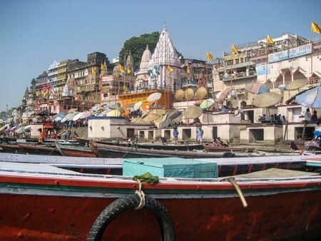 varanasi: Varanasi, India - 17 April 2007 - Boats moored on the banks of the river Ganges in the Holy City of Varansi Editorial