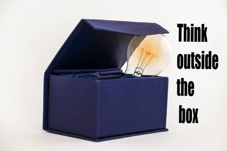 imaginative: Blue box with glowing bulb and Think outside the box text on white background