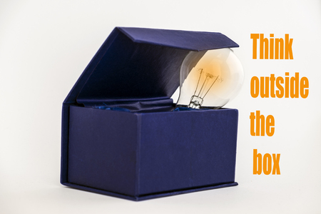 imaginative: Blue box on white background with Think outside the box text Stock Photo
