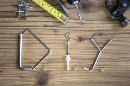 woodcraft: DIY written with home improvement accessories lay flat on wooden background