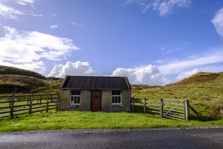 outbuilding: Old farm outbuilding in remote Isle of Skye Scotland countryside with wooden fence and metal gate
