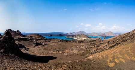 Beautiful Galapagos landscape view of Bartolome Island with mountains, sea and blue sky