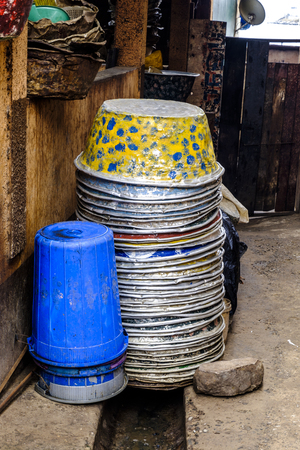 stack of brightly patterned tin buckets waiting to be used at