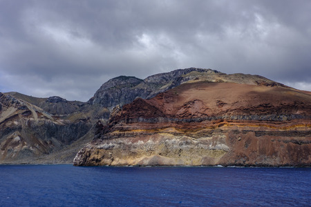 Unusual colors and layers of rock formation on coastline of remote Ascension Island in South Atlantic Ocean