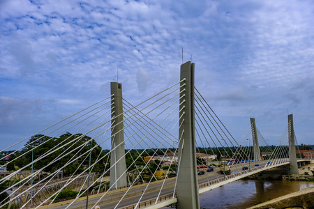 Traffic crosses modern suspension Bridge, 4 April, over Catumbela River linking cities of Benguela and Lobito in Angola with old bridge also visible