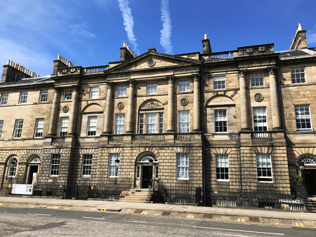EDINBURGH, SCOTLAND - MAY 07 2018: Vapour trails in blue sky above elegant Georgian architecture of Bute House in Charlotte Square Edinburgh, official residence of the First Minister of Scotland Editorial