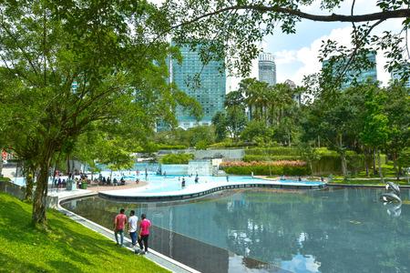 klcc: KLCC city Park. City park in sunny day near Petronas twin towers, KLCC  Kuala Lumpur Malaysia. Editorial