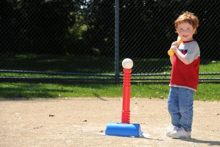 A young boy steps up to bat during t-ball practice at a neighborhood softball diamond. photo