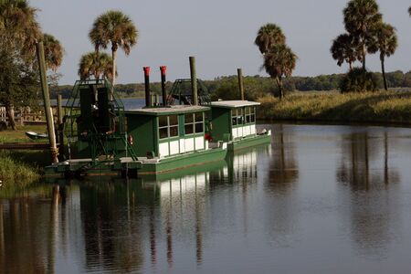 Airboats in a peaceful river scene Banco de Imagens