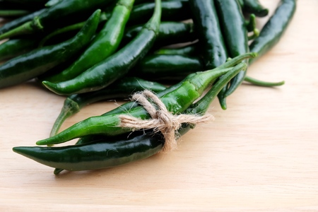 flavouring: green chili peppers. Domestic cultivation extra hot chilli burn. Growing chili peppers. Spicy seasoning food. Healthy spices.
