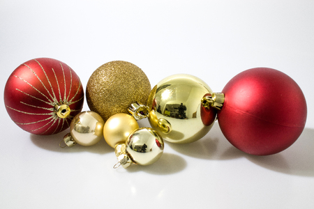 red and gold christmas balls decorations in a white background stock photo 93333451