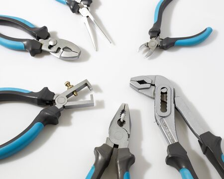 Blue flat-nose pliers in a white background composition