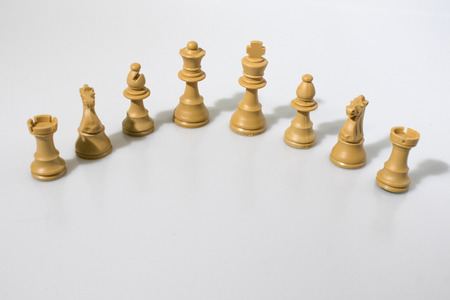 Chess pieces composition in a white background