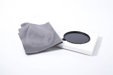 Lens filter reflex polarized filter in a white background composition Stock Photo