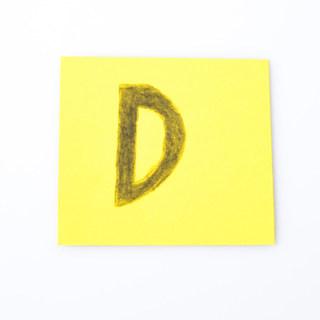 D alphabet letter handwrite on a yellow paper composition