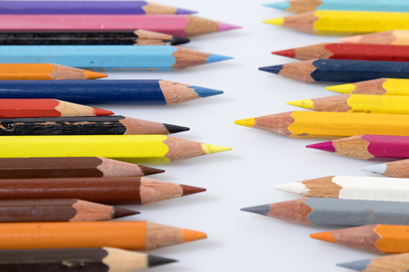 Colored pencils in a white background composition