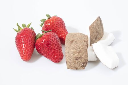 Strawberries and coconut in a white background composition