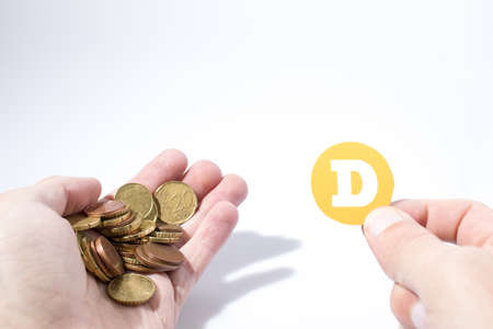 Cryptocurrency hand is holding euro coins and a dogecoin in a composition