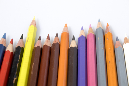 Colored pencils in a white background Фото со стока