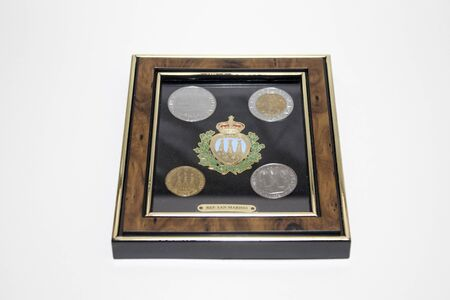 Collections, antique san marino coins in a frame composition Archivio Fotografico - 99997209