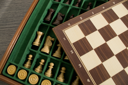 Chessboard set with chess made with wood composition