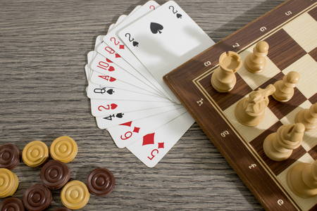 Table game composition with chess and cards composition