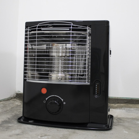 Black kerosene heater in a white background composition