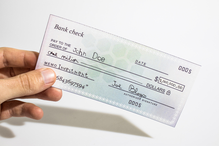 Holding a million dollar bank check isolated in a white background composition Imagens