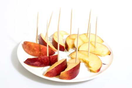 slices of peach on a plate in a white background composition