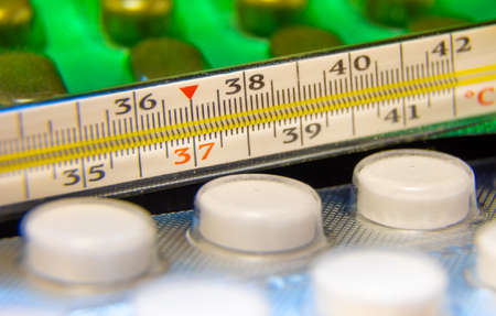 temperature on the thermometer is 37C, the thermometer lies among the tablets