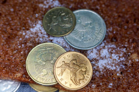 coin 50 penny between other rubles and bread with salt