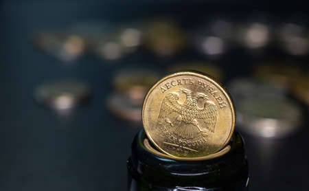 coin of 10 rubles is in the neck of a glass bottle