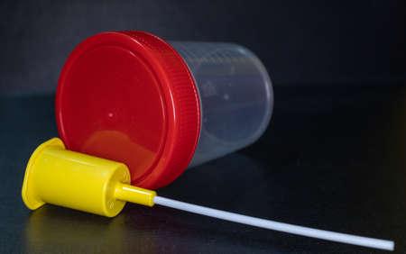 Plastic jars for medical tests on black background