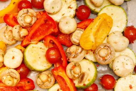 grilled colored vegetables lie together on white paper