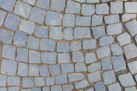 Stone blocks in the walkway - patterned paving tiles