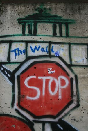 Stopsign painted on the Berlin Wall Stock Photo