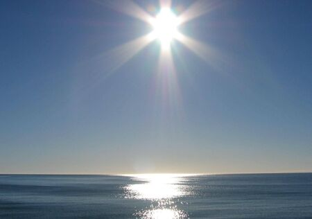 Sun shines over the ocean at Kaikoura, New Zealand