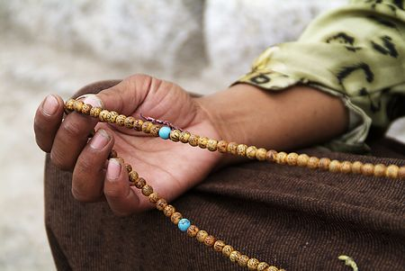 Hand with necklace in Lhasa, Tibet Stock Photo