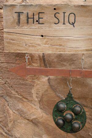 siq: Entrance sign of the city of Petra in Jordan