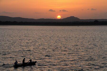 Sunset at lake Polonnaruwa in Sri Lanka photo