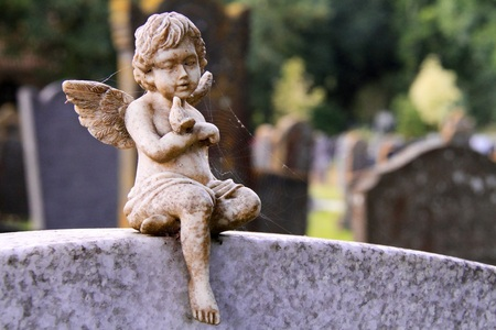 Angel on a tombstone Stock Photo
