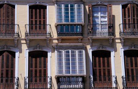 Spanish windows in the city of Malaga Stock Photo