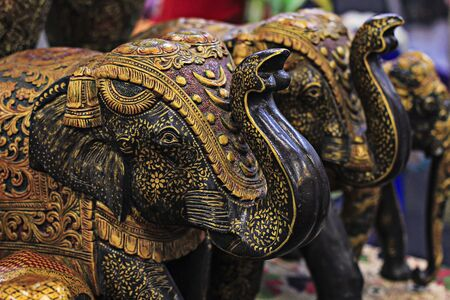 head toy: india, elephant,symbol, decoration,culture, figure, animal,  asia, statue, vintage,  traditional, toy,  asian,  thailand, travel, wooden, head,  several, carving, ancient, old,  handicrafts, bronze,decorate, fine