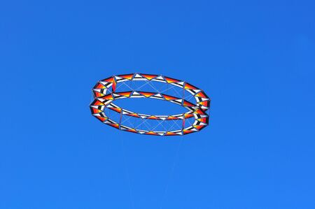Circular kite flying in a blue sky Stock Photo - 12769838